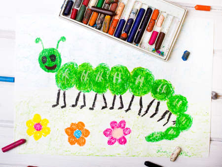 cartoon larva: colorful drawing: green caterpillar with happy face