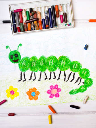 children caterpillar: colorful drawing: green caterpillar with happy face
