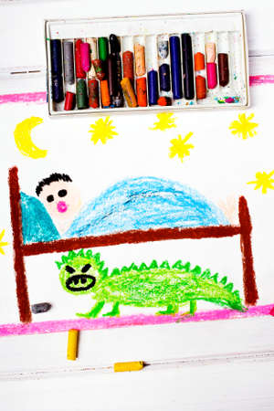 under the bed: colorful drawing: scary monster under the childrens bed Stock Photo