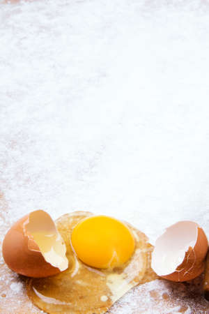 farina: baking background with pastry board, rolling pin and broken egg Stock Photo