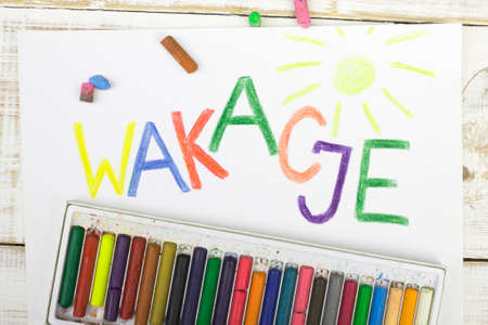 coloured pencils: Polish word wakacje written in colored pencils