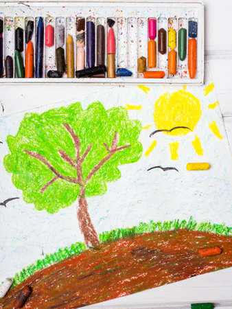 kid drawing: Colorful drawing: Tree on the hill Stock Photo
