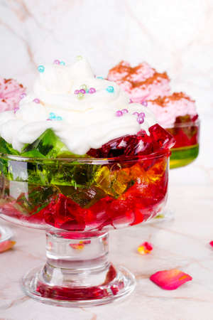 tidbit: Colorful jelly with whipped cream and candy topping