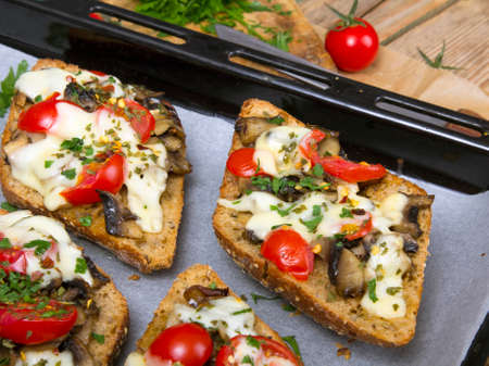 delicious bruschetta with tomatoes, cheese and mushrooms