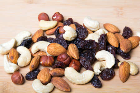 dried food: Trail mix on wooden background