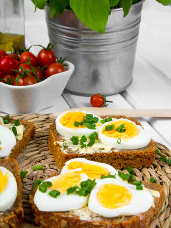 whole wheat: Healthy whole wheat sandwiches with eggs and chives Stock Photo