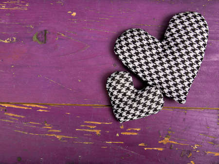 houndstooth: houndstooth hearts on a pinkbackground
