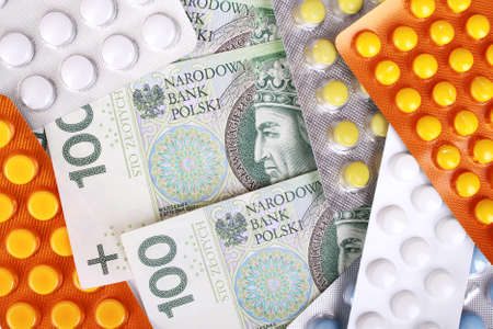 zloty: Zloty money bills and colorful pills