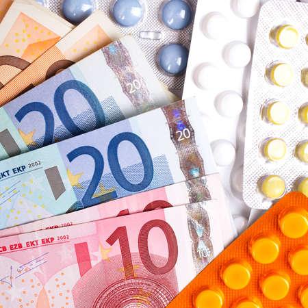 Euro money bills and colorful pills Stock Photo