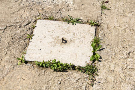the hatch: square hatch on a concrete background