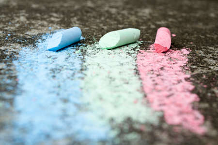 Three colored stripes, drawing with chalk on asphalt