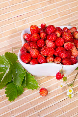 Wild strawberries in a small bowl