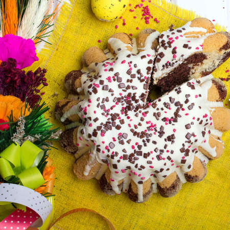 sugar palm: Glazed Easter cake with sprinkles and colorful eggs Stock Photo
