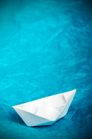 paper ship in blue tissue paper - childrens idea of the ship at sea