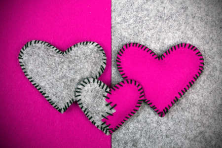 misfit: Three felt hearts on two different backgrounds, valentines composition