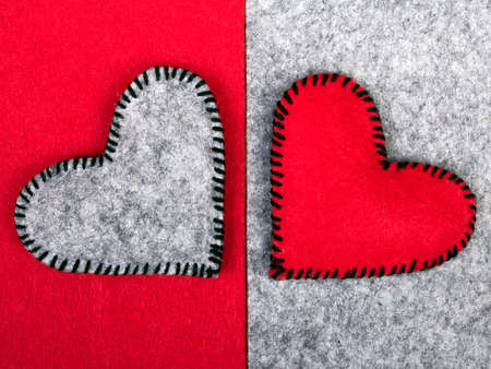 misfit: Two hearts on different backgrounds, metaphor of relationship Stock Photo