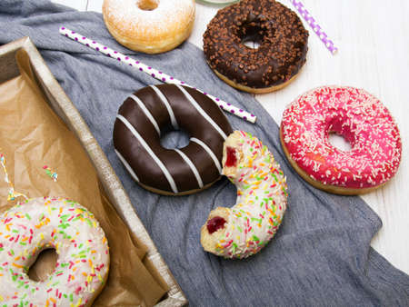 shrove: Colorful donuts with chocolate and icing, selective focus Stock Photo