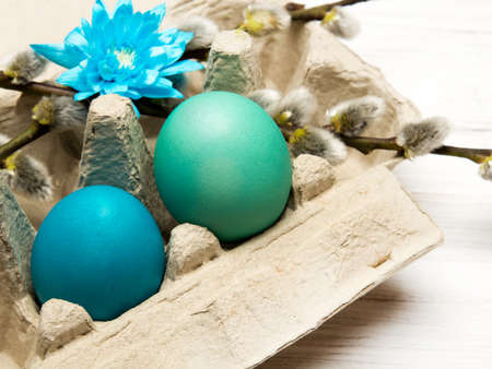 Easter background with eggs and catkins on white wooden background, copy space Stock Photo