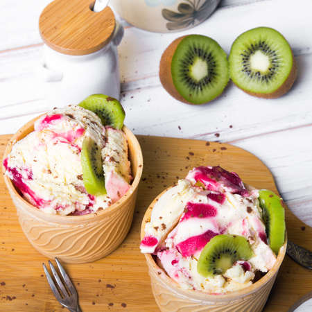 Delicious ice cream in a cup with tasty fruits Stock Photo