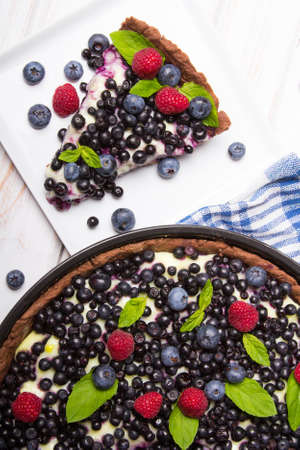 Delicious tart with blueberries and raspberries