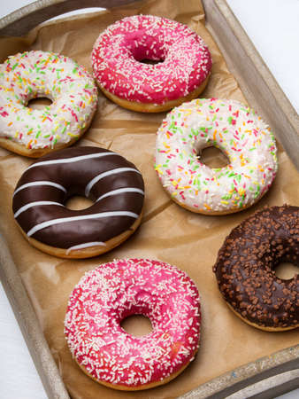 Colorful donuts with chocolate and icing, selective focus Stock Photo