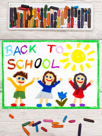 Photo of colorful drawing: Word BACK TO SCHOOL and happy children. First day at school.