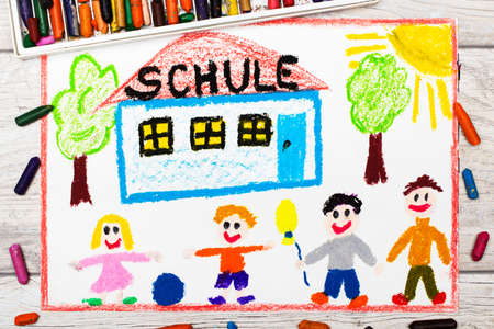 first house: Photo of  colorful drawing: German word SCHOOL, school building and happy children. First day at school.  Stock Photo