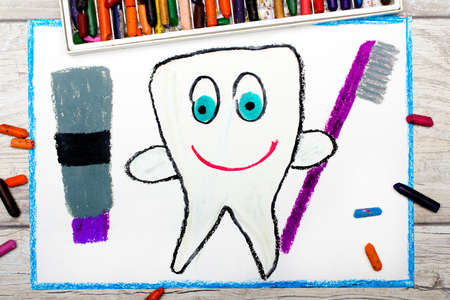 Photo of colorful drawing: smiling healthy tooth holding a toothpaste and a toothbrush