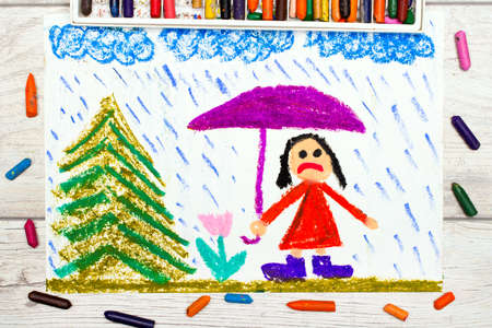 sad little girl: Photo of colorful drawing: Rainy weather and sad little girl holding umbrella. Stock Photo