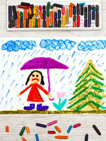 Photo of colorful drawing: Rainy weather and sad little girl holding umbrella. Stock Photo
