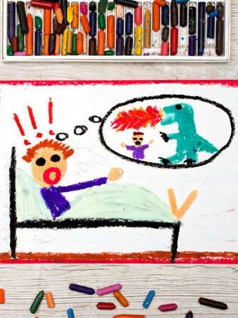 Photo of colorful drawing: little boy has nightmares. Scary nightmare creature