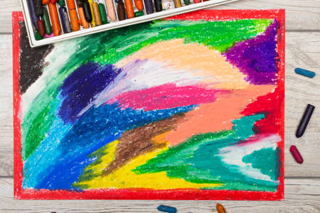 children painting: Photo of colorful drawing and oil pastels crayons, texture for background.