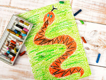 children painting: colorful drawing: snake in the grass Stock Photo