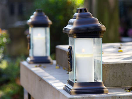 Votive candles at the grave Stock Photo