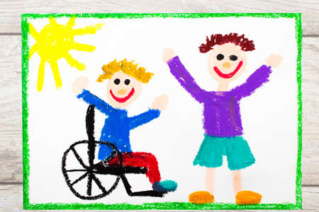 Photo of colorful drawing: Smiling boy sitting on his wheelchair. Disabled boy with a friend Stock Photo