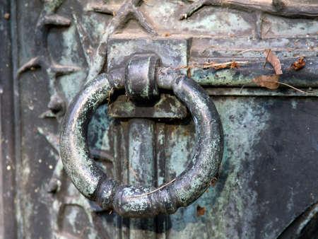 Closeup of a old metal door knocker.