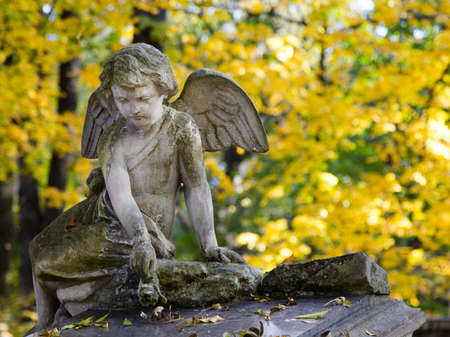 Angel statue at cementery. Relogious symbol, copy space