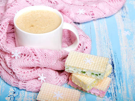 Tasty Christmas coffee or cocoa and sweet cookies on blue wooden background and pink tablecloth. Copy space Stock Photo