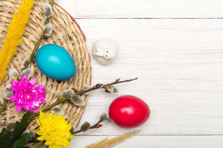Easter background with colorful egg and catkins, copy space