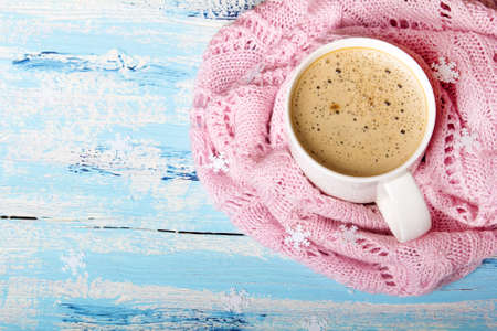 Tasty coffee or cocoa on blue wooden background and pink tablecloth. Copy space Stock Photo