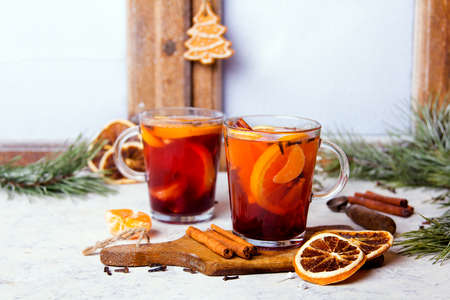 Christmas drink, mulled wine with orange, cinnamon and cloves on white background Archivio Fotografico