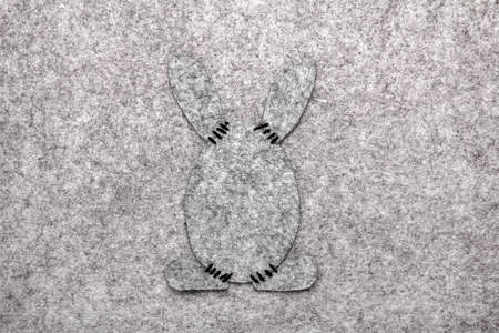Easter background with Easter bunny shape- gray felt composition