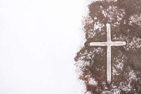 Cross and ash on white
