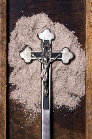 Cross and ash - symbol of Ash Wednesday. Imagens