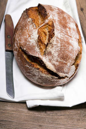 Tasty dark bread  on rustic wooden background, copy space. Wholemeal bread. 免版税图像