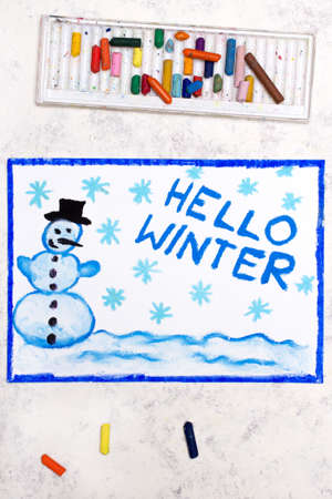 Photo of colorful drawing: Happy snowman and words HELLO WINTER. Banco de Imagens