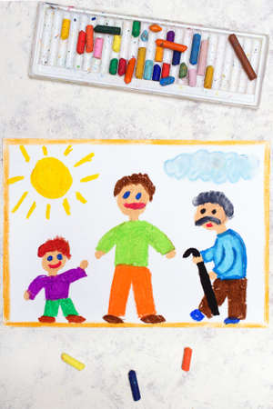 Photo of colorful drawing: Aging process and life cycle. A child, an adult and an elderly person. 免版税图像