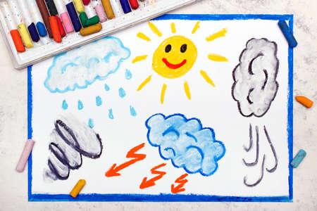 Photo of colorful drawing: Seasons and weather. Hand drawn weather illustrations: sun, rain, wind, storm Фото со стока