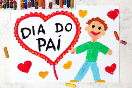 Photo of colorful drawing: Portuguese Fathers day card.Smiling father and big red heart.  Banco de Imagens
