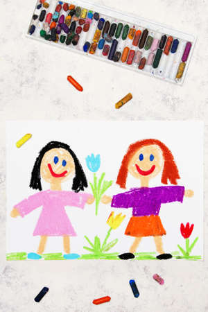 Photo of colorful drawing: two smiling girls. Sisters or friends 版權商用圖片